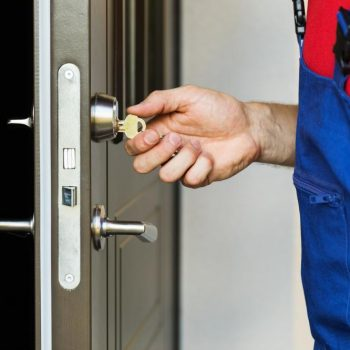 residential locksmith turning key in door lock
