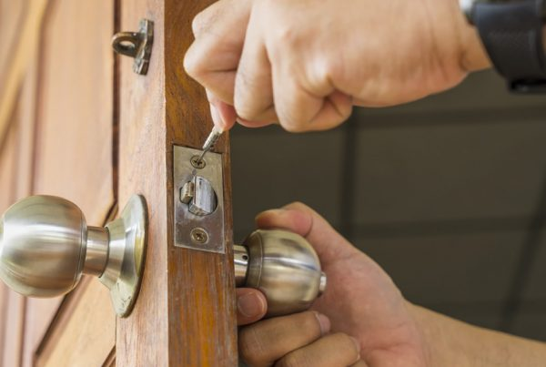 locksmith replacing residential lock on door