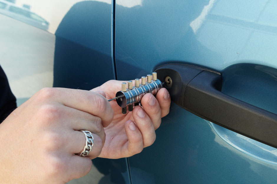 man picking car door lock